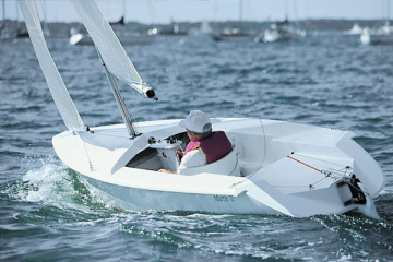 Photo of a disabled person sailing a small boat
