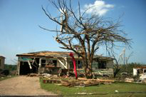 photo of damaged house that needs to be rebuilt