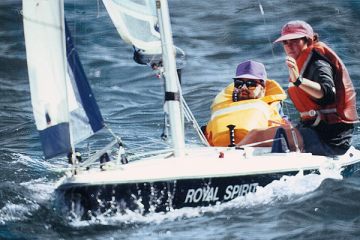 Photo of a sailing assistant with a disabled sailor.